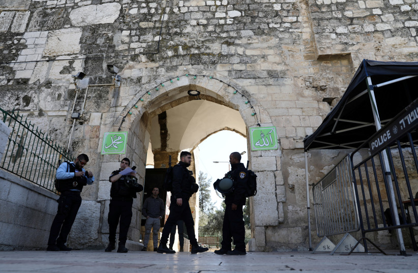 Israeli police officers secure the area following a suspected shooting attack in which an Israeli policeman was injured lightly near the entrance to the compound known to Muslims as the Noble Sanctuary and to Jews as Temple Mount in Jerusalem's Old City February 6, 2020 (photo credit: AMMAR AWAD/REUTERS)