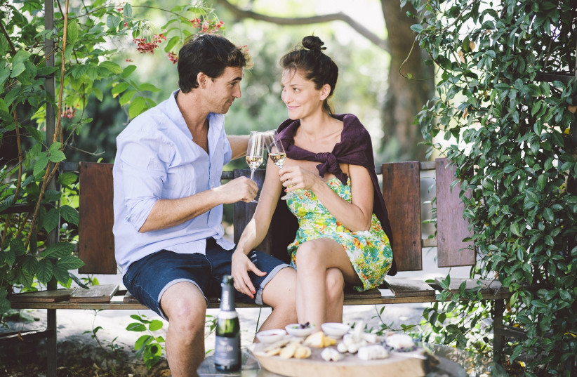 A couple share a romantic glass of champagne in the Golan Heights (photo credit: Courtesy)
