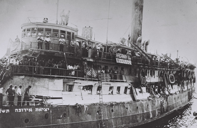 The 'EXODUS' ship following the Britsih takeover, with damage to its makeshift barriers. The banner reads, 'Haganah Ship Exodus 1947.' (photo credit: Wikimedia Commons)