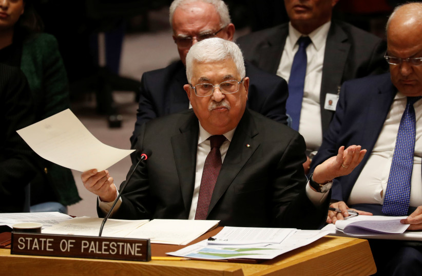 Palestinian President Mahmoud Abbas speaks during a Security Council meeting at the United Nations in New York, U.S., February 11, 2020 (photo credit: REUTERS/SHANNON STAPLETON)
