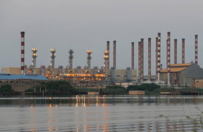 A general view of Abadan oil refinery in southwest Iran, is pictured from Iraqi side of Shatt al-Arab in Al-Faw south of Basra, Iraq September 21, 2019 (photo credit: REUTERS/ESSAM AL-SUDANI)