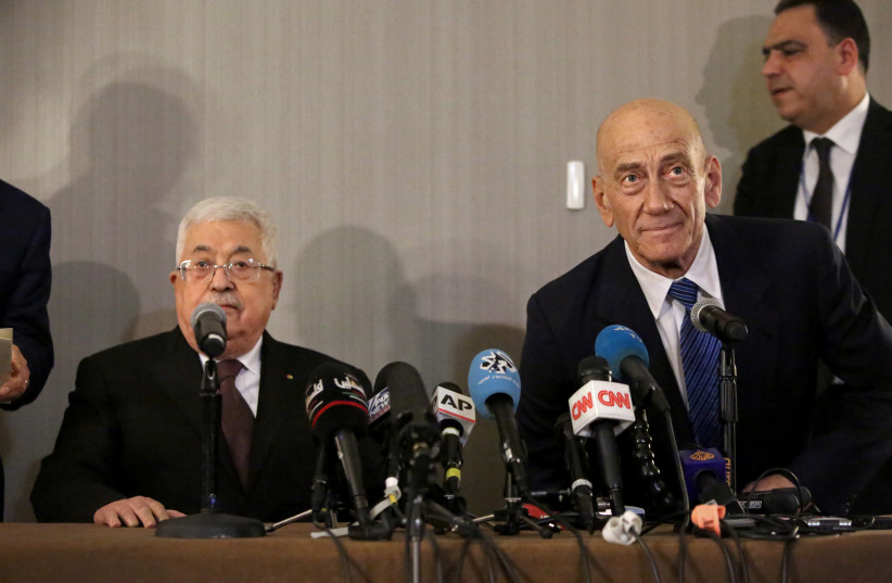 Palestinian President Mahmoud Abbas and former Israeli Prime Minister Ehud Olmert hold a news conference in New York (photo credit: REUTERS)