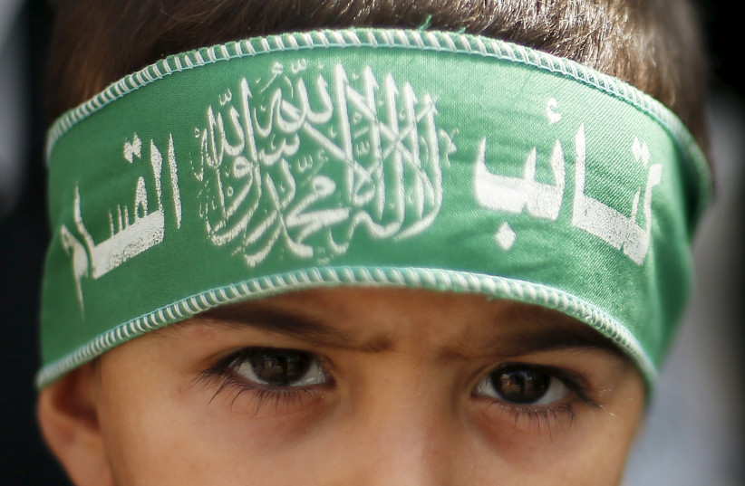 A Palestinian boy wears the headband of Hamas' armed wing as he takes part in a rally to protest against an Israeli police raid on Jerusalem's al-Aqsa mosque, in Gaza City September 15, 2015 (photo credit: REUTERS/SUHAIB SALEM)