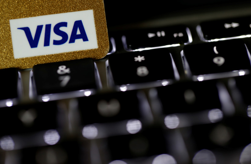 A Visa credit card is seen on a computer keyboard in this picture illustration (photo credit: REUTERS)