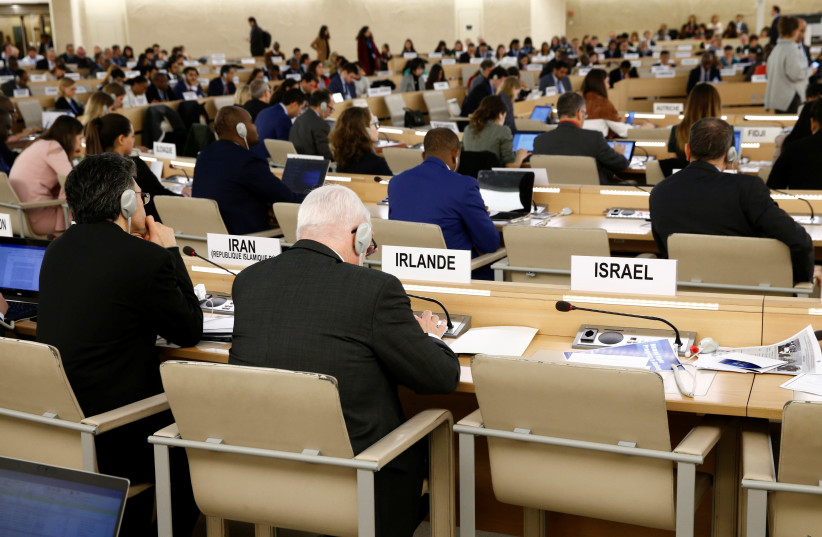 The empty seat of Israel is pictured during a session of the Human Rights Council at the United Nations in Geneva, 2019 (photo credit: DENIS BALIBOUSE/REUTERS)