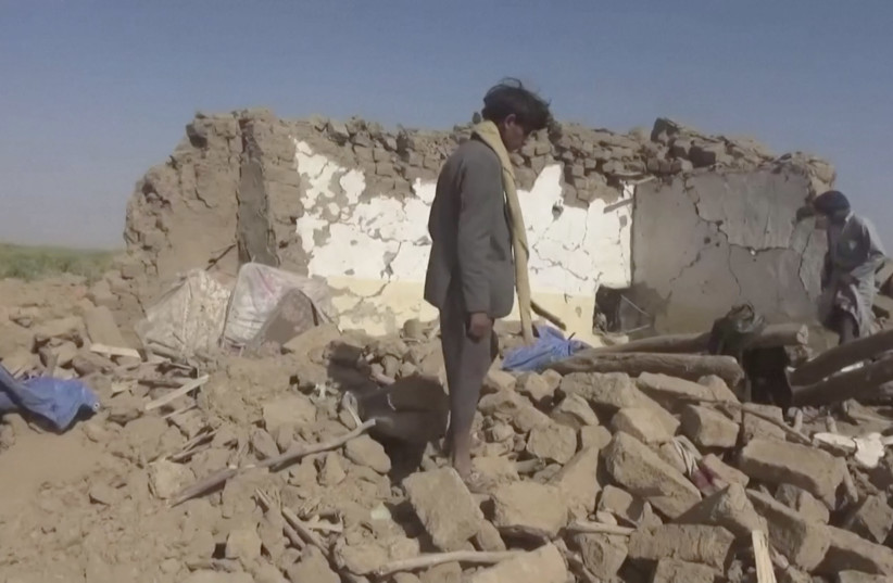 People rummage through rubble after an air strike in Al-Jawf province, Yemen, February 15, 2020 in this still image taken from a video (photo credit: HOUTHI MEDIA CENTER VIA REUTERS)
