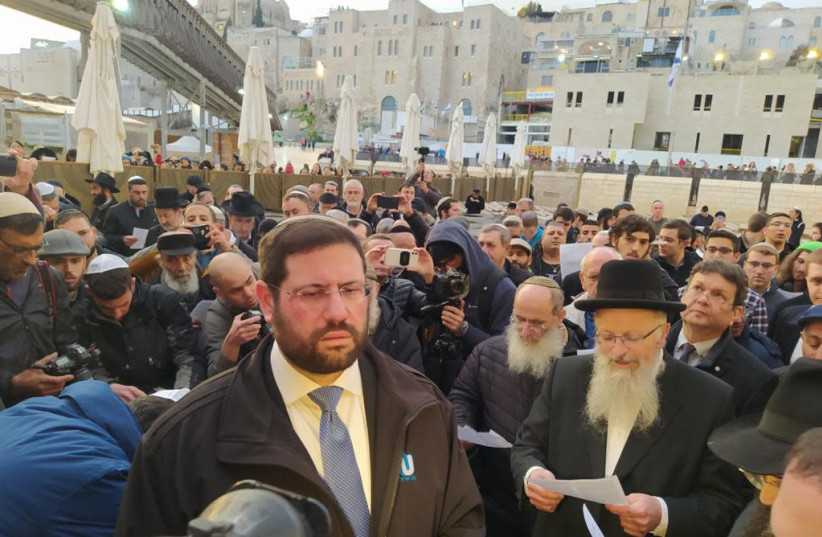 Chief Rabbi of Safed and president of the Rabbinical Community Association Rabbi Shmuel Eliyahu andRabbi Avi Berman, executive officer of Israeli branch of the Orthodox Union among the dozens who gathered at the Western Wall to pray for the people affected by the coronavirus on February 16, 2020 (photo credit: OU ISRAEL)
