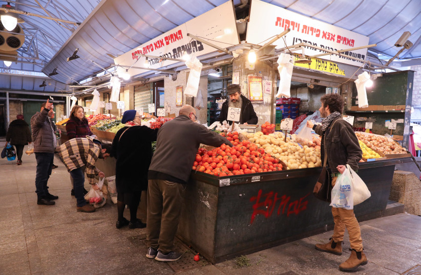 People are seen shopping for produce at the Mahaneh Yehuda shuk in Jerusalem. (photo credit: MARC ISRAEL SELLEM/THE JERUSALEM POST)