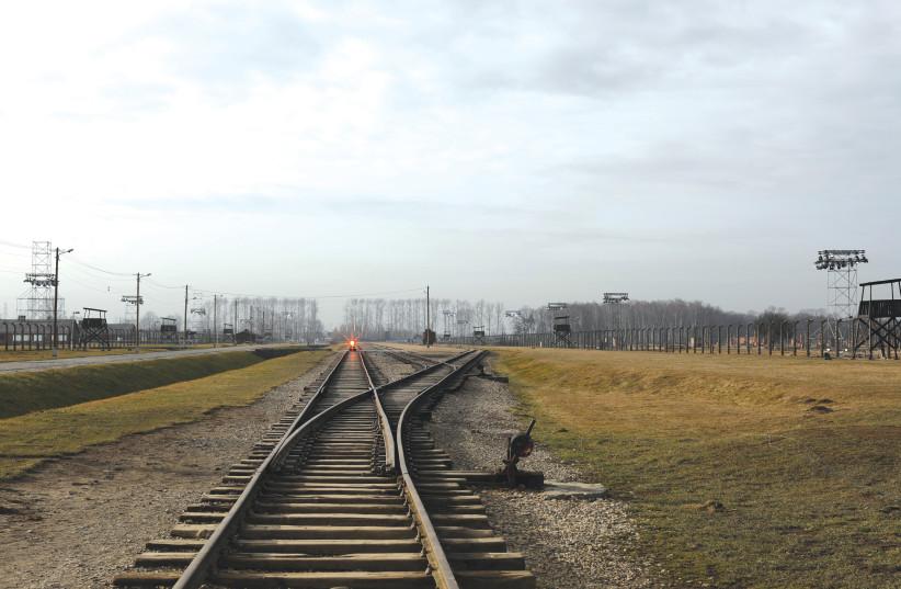 TRAIN TRACKS at Auschwitz. (photo credit: REUTERS)