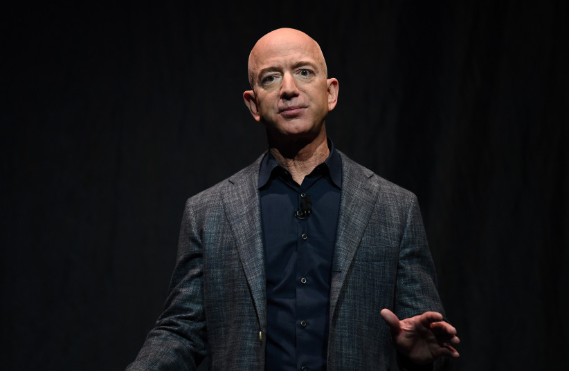 FILE PHOTO: Founder, Chairman, CEO and President of Amazon Jeff Bezos speaks during an event about Blue Origin's space exploration plans in Washington (photo credit: REUTERS)