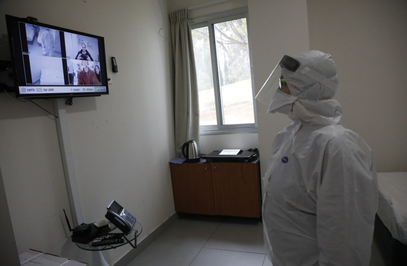 An employee at Sheba Medical Center at Tel Hashomer testing the special area where the Israelis who were aboard the Diamond Princess cruise ship will be kept in quarantine (photo credit: SHAUL GOLAN)