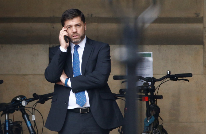 British Conservative MP Stephen Crabb is seen near the Houses of Parliament in London, Britain (photo credit: REUTERS/HENRY NICHOLLS)