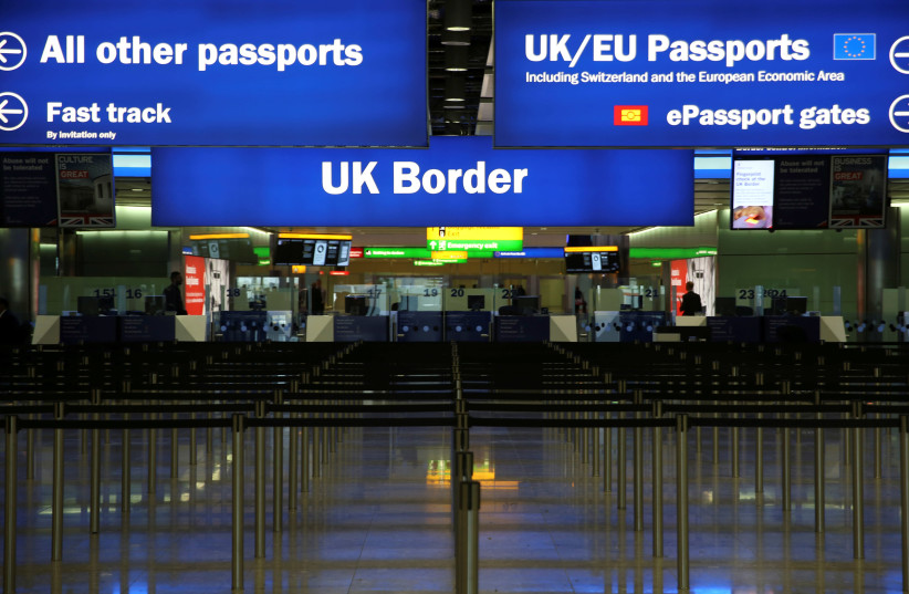 FILE PHOTO: UK Border control is seen in Terminal 2 at Heathrow Airport in London (photo credit: REUTERS)