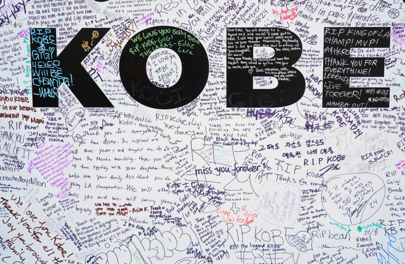 Walls for fans to write tributes to Kobe Bryant in Microsoft Square near the Staples Center after a helicopter crash killed the retired basketball star, in Los Angeles, California, U.S., January 28, 2020 (photo credit: REUTERS/KYLE GRILLOT)