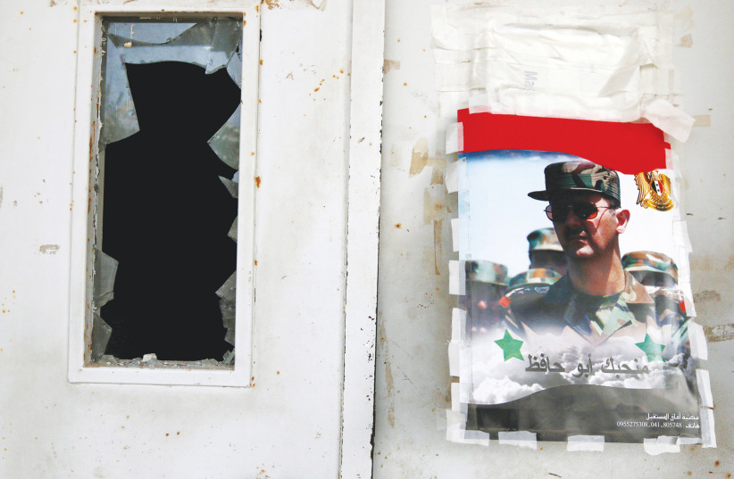 A POSTER of Syrian regime leader Bashar Assad in Latakia.  (photo credit: REUTERS)