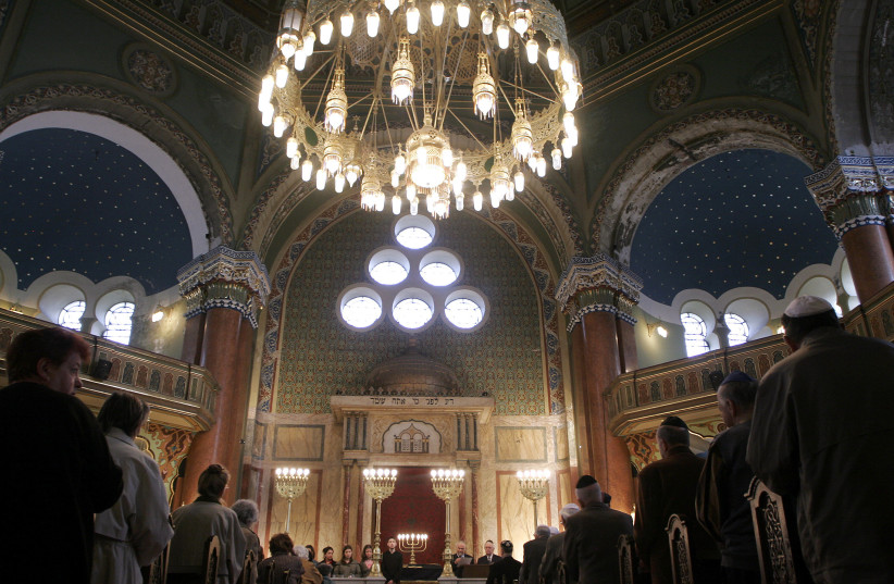 Members of Bulgarian Jewish community stand in silence during a service in the Sofia synagogue (photo credit: NIKOLAY DOYCHINOV/REUTERS)