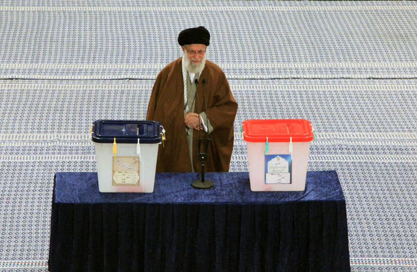 Iran's Supreme Leader Ayatollah Ali Khamenei casts his vote at a polling station during parliamentary elections in Tehran, Iran February 21, 2020 (photo credit: REUTERS)