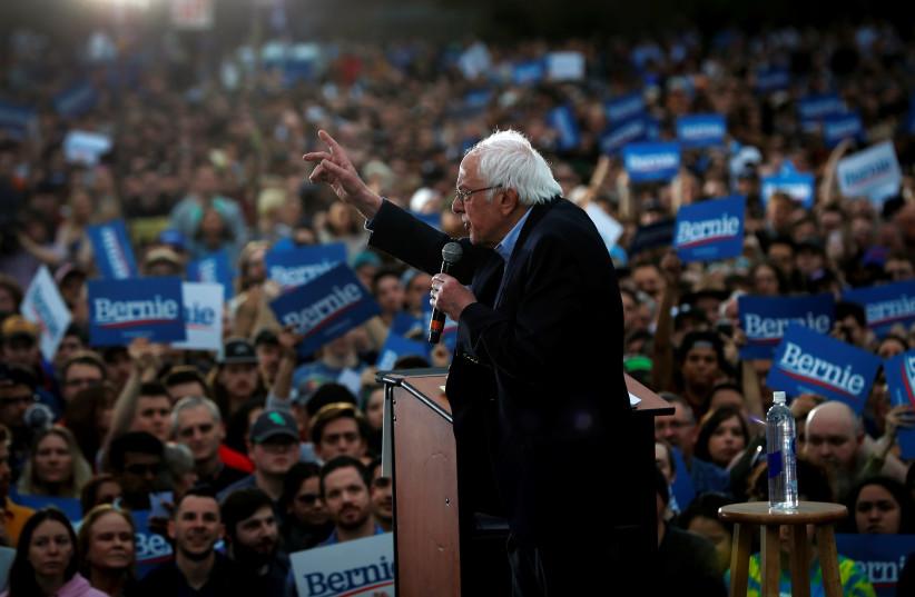 Democratic U.S. presidential candidate Senator Bernie Sanders speaks an outdoor campaign rally in Austin, Texas, U.S., February 23, 2020. (photo credit: REUTERS/MIKE SEGAR)