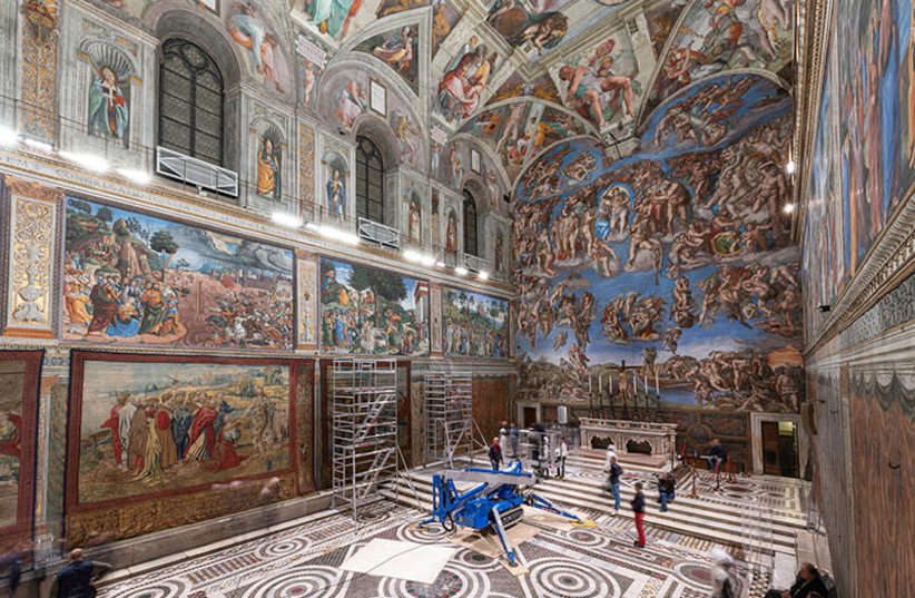 A tapestry designed by Renaissance artist Raphael is installed on a lower wall of the Sistine Chapel at the Vatican as part of celebrations marking the 500th anniversary of his death (photo credit: REUTERS)