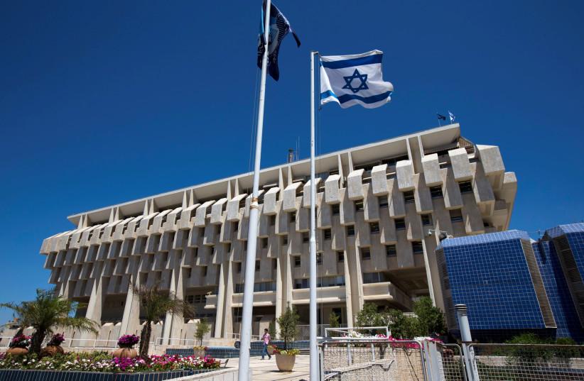 An Israeli flag flutters outside the Bank of Israel building in Jerusalem (photo credit: REUTERS)
