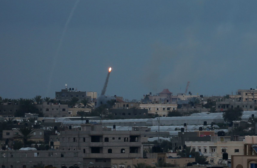 A rocket is fired towards Israel, in the southern Gaza Strip February 24, 2020 (photo credit: REUTERS/IBRAHEEM ABU MUSTAFA)
