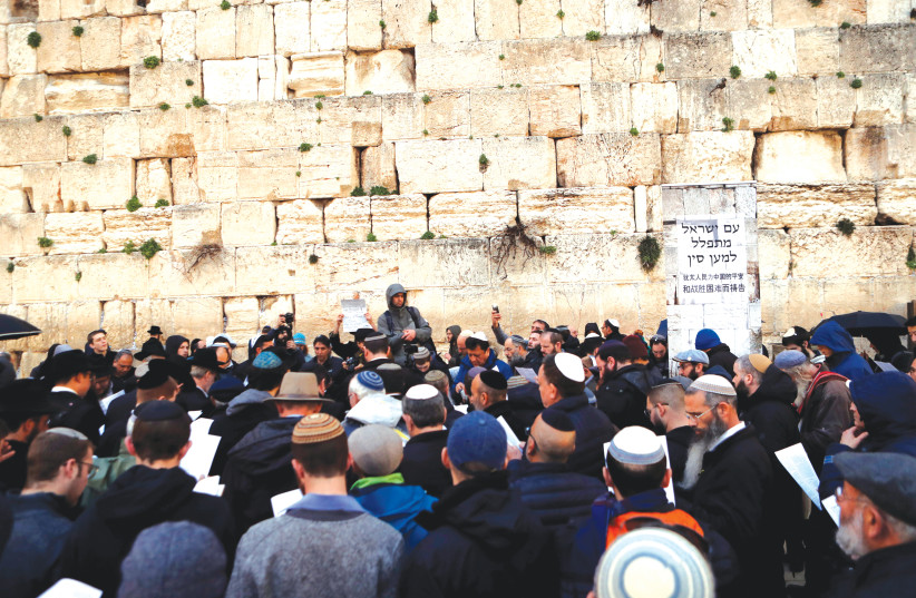Jews gather at the Western Wall on February 16 under the slogan,  'The Nation of Israel prays for China,' calling for the eradication of the coronavirus plague (photo credit: YAAKOV LEHMAN)