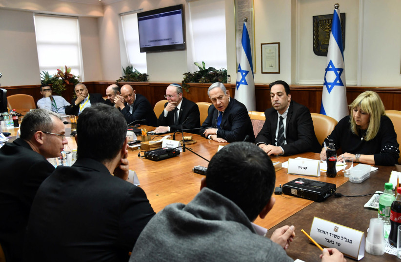 Prime Minister Benjamin Netanyahu chairs a meeting on Israel's preparations for the implications of the coronavirus, Prime Minister's Office in Jerusalem, Febraury 25, 2020 (photo credit: HAIM ZACH/GPO)