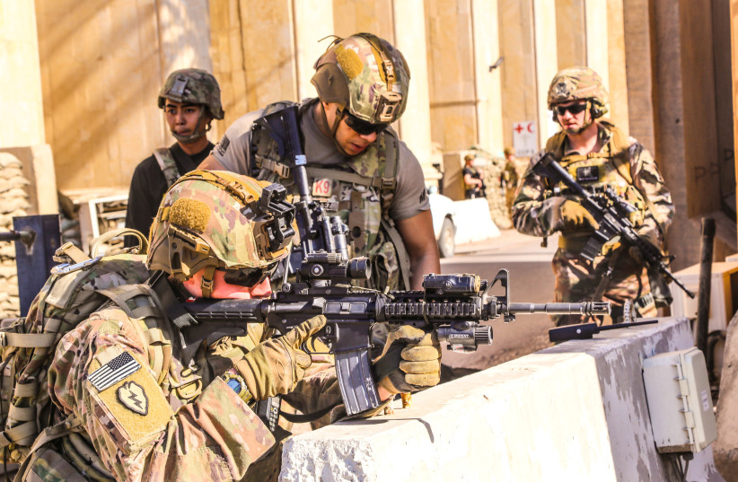 U.S. Army soldiers from 1st Brigade, 25th Infantry Division, Task Force-Iraq, man a defensive position at Forward Operating Base Union III in Baghdad, Iraq, December 31, 2019 (photo credit: U.S. ARMY/STAFF SGT. DESMOND CASSELL/TASK FORCE-IRAQ PUBLIC AFFAIRS/HANDOUT VIA REUTERS)