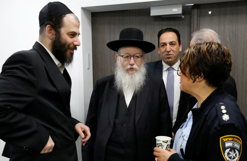 Israeli Health Minister Yaakov Litzman arrives for a situation assessment meeting regarding the novel coronavirus, at the Health Ministry in Tel Aviv, Israel February 23, 2020 (photo credit: REUTERS/JACK GUEZ)