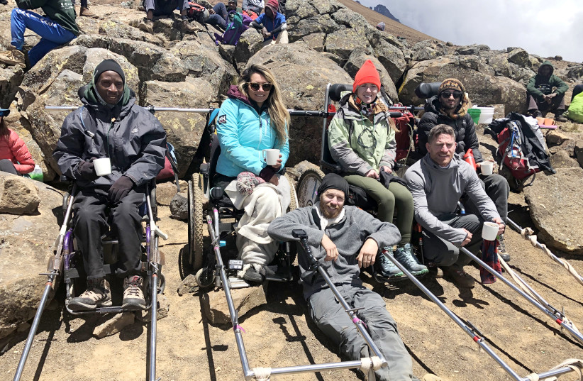 TO THE summit: (front from left) Paratrek CEO Omer Zur and co-worker Rowee Benbenishty; cliimbers with disabilities (back row, left to right) in Paratreks: Arnold John, Marcela Maranon, Starla Hiliard-Barnes and Arnon Amit (photo credit: Courtesy)
