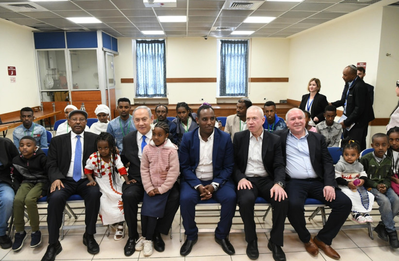 Prime Minister Benjamin Netanyahu is seen meeting with Ethiopian olim. (photo credit: AMOS BEN-GERSHOM/GPO)