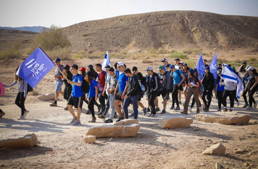 MASA ISRAELI participants at the Khan Be'erot camping area at the Ramon Crater (Makhtesh Ramon). (photo credit: GUY YEHIELI)