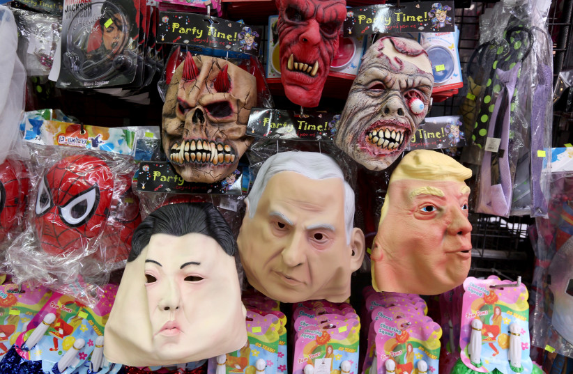 A BRILLIANT future: Purim masks on sale at Jerusalem's Mahaneh Yehuda marke (photo credit: MARC ISRAEL SELLEM)