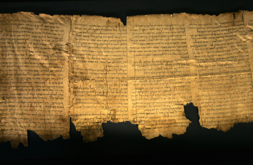 Sections of the ancient Dead Sea scrolls are seen on display at the Israel Museum in Jerusalem May 14, 2008. (photo credit: BAZ RATNER/REUTERS)