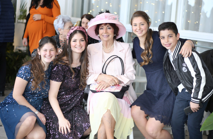 BARBARA OBERMAN with three granddaughters and a great-grandson at a recent family wedding (photo credit: KFIR HARBI)