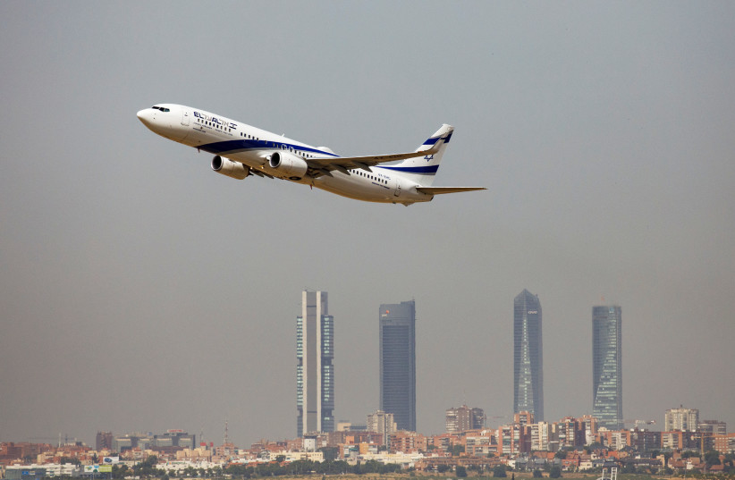 An El Al Israel Airlines Boeing 737-900ER airplane takes off from the Adolfo Suarez Madrid-Barajas airport as seen from Paracuellos del Jarama, outside Madrid, Spain, August 8, 2018 (photo credit: REUTERS/PAUL HANNA)