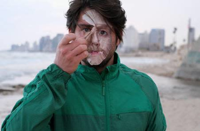 """""""Public Interaction: A Printed Mask on my Face"""" (2019) (photo credit: GUY AON AND YUKI JAMES)"""