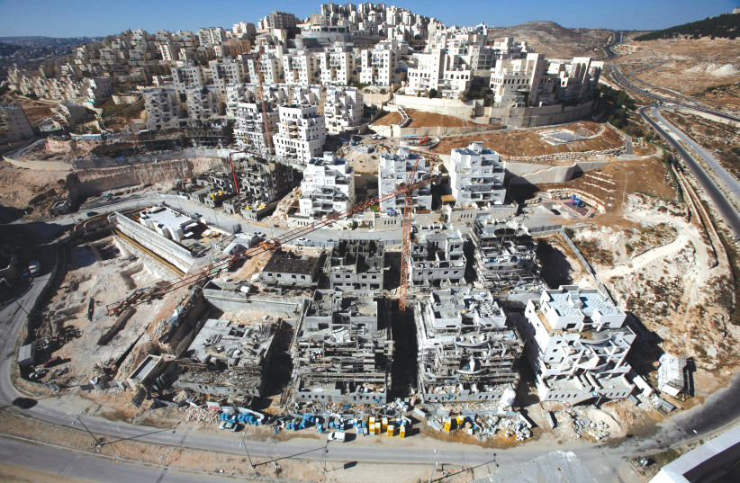HOUSES UNDER construction in Har Homa. (photo credit: REUTERS)