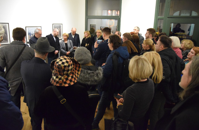 Guests view the exhibition of Meer Axelrod's 'Nazi Occupation' series in Zagreb, Croatia. (photo credit: MAYA LASKOVICH)
