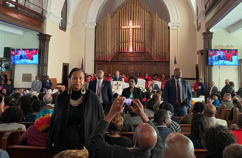 """Attendees stand and turn their backs on Democratic U.S. presidential candidate Michael Bloomberg as he talks about his plans to help the U.S. black community during a commemoration ceremony for the 55th anniversary of the """"Bloody Sunday"""" march in the Brown AME Church in Selma, Alabama, U.S., March 1 (photo credit: REUTERS/JOSEPH AX)"""