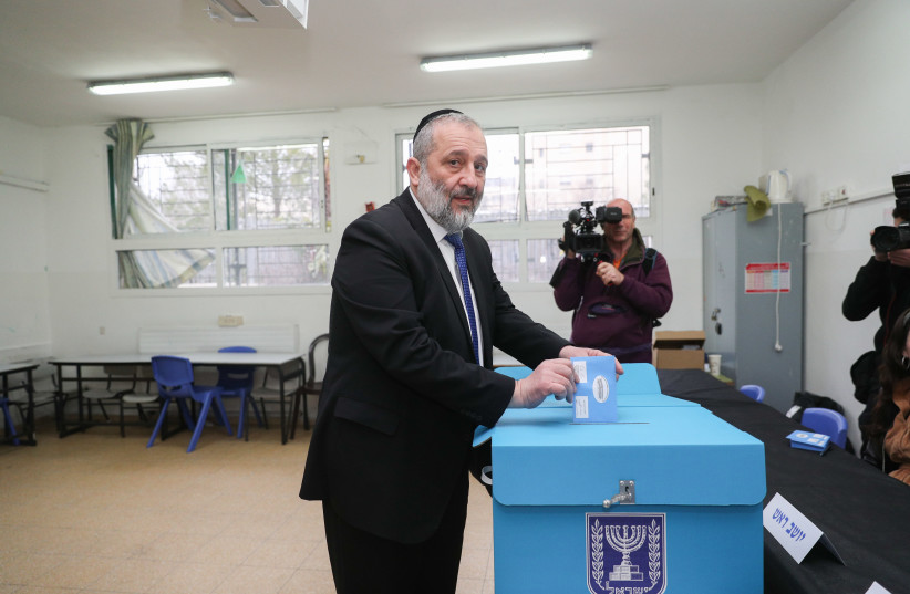 Shas party chairman and Interior Affairs Minister, Aryeh Deri, casts his ballot at a voting station in Jerusalem, during the Knesset Elections, on Marc 02, 2020. (photo credit: YONATAN SINDEL/FLASH90)