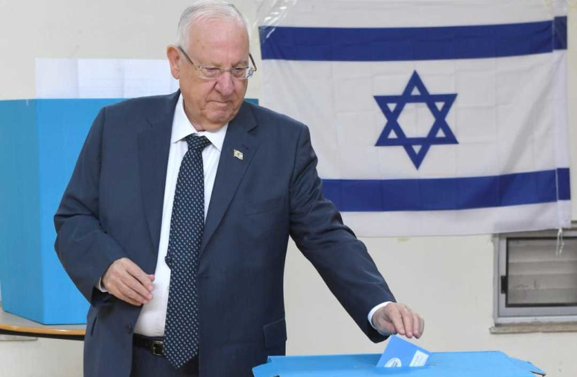 President Reuven Rivlin voting for the 23rd Knesset on Monday (photo credit: MARK NEYMAN/GPO)