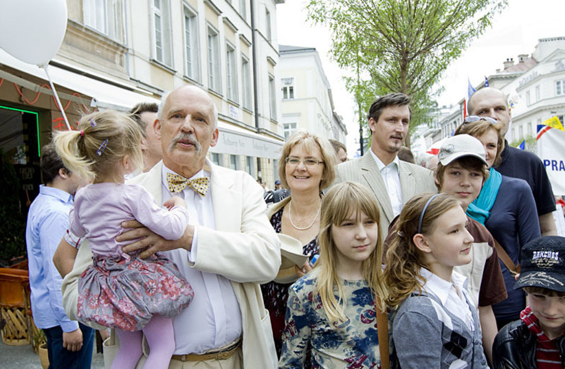 Janusz Korwin-Mikke with his family.  (photo credit: Wikimedia Commons)