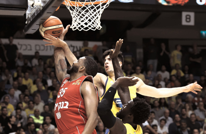 TASHAWN THOMAS (right) and Hapoel Jerusalem, as well as Deni Avdija (left) and Maccabi Tel Aviv will both suit up for big continental games tonight at home.  (photo credit: DANNY MAROM)