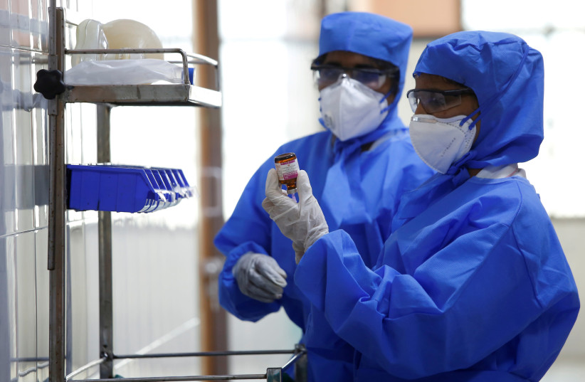 Medical staff with protective clothing are seen inside a ward specialised in receiving any person who may have been infected with coronavirus, at the Rajiv Ghandhi Government General hospital in Chennai (photo credit: REUTERS)