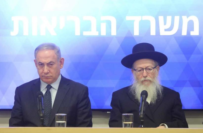 Prime Minister Benjamin Netanyahu adn Health Minister Ya'acov Litzman address the nation on the coronavirus epidemic, March 4, 2020 (photo credit: MARC ISRAEL SELLEM/THE JERUSALEM POST)