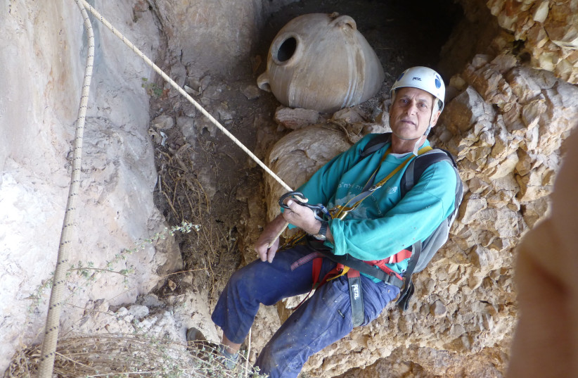 Dr. Yinon Shivtiel at one of the caves used during the Jewish Great Revolt against the Romans as described by Josephus. (photo credit: YINON SHVIETEL)