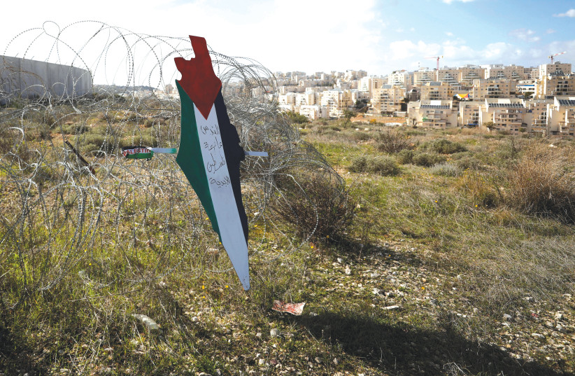 A map with the colors of the Palestinian flag reading 'Jerusalem is the eternal capital of Palestine' near Bilin.  (photo credit: MOHAMAD TOROKMAN/REUTERS)