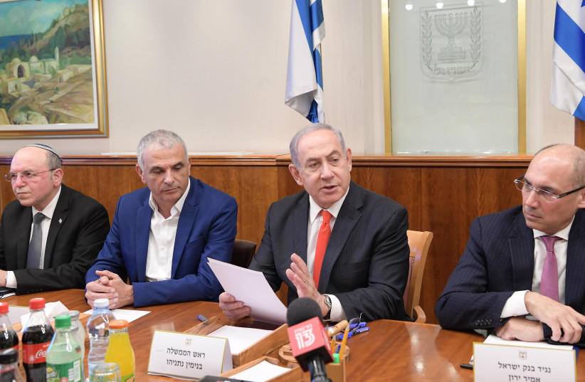 Prime Minister Benjamin Netanyahu discusses the impact of coronavirus with representatives from the Finance Ministry, March 5, 2020 (photo credit: AMOS BEN-GERSHOM/GPO)