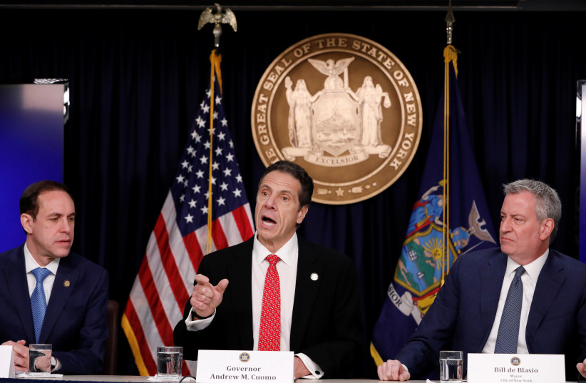 Commissioner of Health for New York State Howard Zucker, New York Governor Andrew Cuomo and New York City Mayor Bill de Blasio deliver remarks at a news conference. New York, U.S., March 2, 2020. (photo credit: ANDREW KELLY / REUTERS)